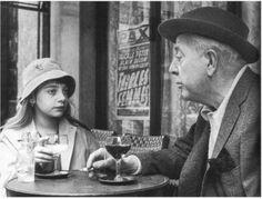 Robert Doisneau, Jacques Prévert and his daughter, Michèle © Atelier Robert Doisneau tag: poetry wine