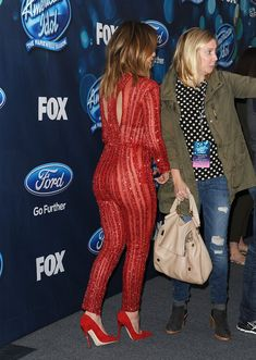| Just Try to Look Away From Jennifer Lopez in This Sexy, Sparkling Red Jumpsuit | POPSUGAR Latina Photo 4