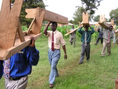 Assembly preparation in Mbozi, Tanzania. Benches were carried from a Kingdom Hall about a mile away from the assembly location.