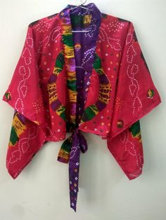 Short Kimono Shrugs The Summer Cardigan for Women. Shrugs top dress can also be worn on jeans. Shrugs is lightweight and feminine, the perfect accessory of dress or top. The Shrugs is loose and super comfortable dress for women made with vintage sari saree fabric with vibrant colors The dress can Kimono Shrug, Kimono Dress, Kimono Top, Bridal Shower Gifts For Bride, Bridal Gifts, Cardigans For Women, Blouses For Women, Shrugs And Boleros, Summer Cardigan