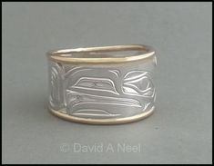 Silver and gold are a striking contrast when used together - Raven ring  #northwestCoastIndianArt #firstNationsArt #nativeArt #nativeAmericanArt #davidNeel