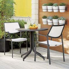 Meet the sleek, affordable outdoor collection for the fashionable café set. Perfect for small decks and city balconies, Largo's lightweight design is easy to arrange, stack and store, yet it's so durable all dining pieces are certified for commercial use. Stacking dining chairs with flared frames in weather-resistant, charcoal powdercoated aluminum offer breezy, comfortable seating in white PVC-coated polyester mesh fabric that's mold- and fade-resistant.