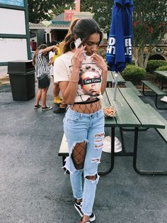 9707f955bfd free Kodak fly supply co t-shirt with fishnet tights ripped jeans and low  top
