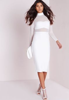 Work some major Kim K vibes in this white midi dress this season. With mesh fabric to the top with long sleeves, high neck feature and fitted skirt this dress will ensure all eyes are on you. Team over white triangle bralet and lace up heel...