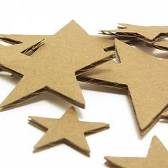 Corrugated Cardboard Stars could be left natural, painted or dusted with white glitter.