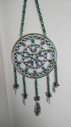 Hey, I found this really awesome Etsy listing at https://www.etsy.com/listing/210069473/custom-peacock-chainmaille-dreamcatcher