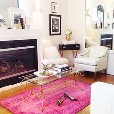 Neutral formal sitting room with a bright pink statement rug. Contemporary classic with eclectic touches.