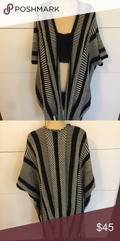 FREE PEOPLE white + black striped poncho Free People black and white striped knit poncho/Ruana with tassels. Has true arm holes and a drapey for. One size fits all. Very cute. Has some wear(a little pilling) but in good shape - super cute! Free People Accessories Scarves & Wraps
