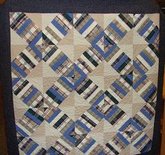 Memory quilt from shirts and pants. You can view this memory quilt and many others on my website. sarahduffeyquilts.com