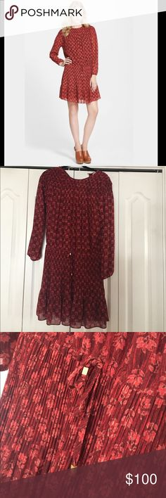 Michael Kors Dress Michael Kors dress worn one time. This dress is adorable and has a drawstring waist where you can make it tighter. Has paisley print on the entire dress in reds and corals. 100% polyester. Michael Kors Dresses Long Sleeve