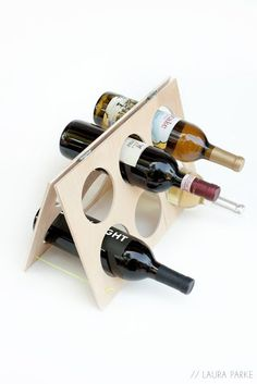 Laura Parke has a great tutorial on how to make an A-frame wine rack with birch plywood and some hinges… Anyone could do this!