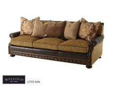 Massoud's L1721 sofa is covered in our Preston Olive fabric and our Echo Moss leather. Check out the fabulous nailhead detail.
