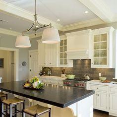 white cabinets dark backsplash