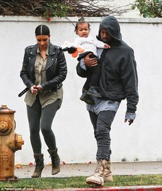 Family time: The trio looked like an advert in their co-ordinating outfits