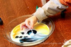 Mixing colors with the color changing milk experiment!