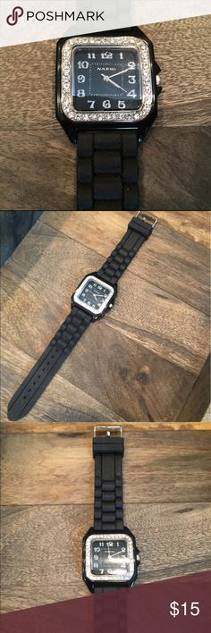 """Ladies Narmi Quartz Crystal Watch Black square face with silver numbers and silver hands. Accented by silver crystals around the face. Black dressy, durable, silicone/rubber band. Measures 9 1/2"""" and is adjustable. Just had a new battery put in. Just a touch of bling! In excellent condition. Narmi Accessories Watches"""