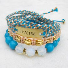IMAGINE stack bracelets friendship bracelet set  macrame beaded hand stamped stretch bracelets blue beige. $55,00, via Etsy.