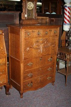 """This Butler's Desk Is Made From Quarter-Sawn Oak. This Piece Of Furnature Was In The Butler's Room. They Were Normally Small And The Butler Would Use This Desk To Write Down Grocery List And Other Tasks. The Bottom Drawers Were For His Clothing And Personals.  Circa. 1900's  Approx. 37""""w. x 19.5""""d. x 51""""h.  Item# 9D107  Price $1,195.00"""