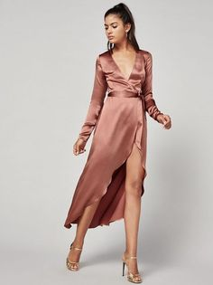 Keep your expectations as low as your neckline #NYE. This is a midi length, wrap dress with a low v neckline and long sleeves.http://bit.ly/2ieS2St