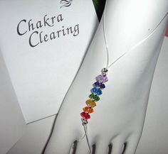 7 Clearing chakra barefoot sandals, also known as foot jewelry, toe thongs, soleless sandals, to wear during yoga, meditation, dance, rituals, or simply to align and balance your chakras. Beautifully created using a Swarovski 4mm bicone crystals to represent each of the seven major chakras. Nothing shines like Swarovski Crystals Strong stretch cord.....One size fits most Root - Red Sacral - Orange Solar Plexus - yellow Heart - green Throat - blue Brow - indigo Crown - violet Easy to wear…