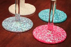 Cover the top of each wine glass stand in different colors of glitter to distinguish which glass belongs to each individual... great idea!!