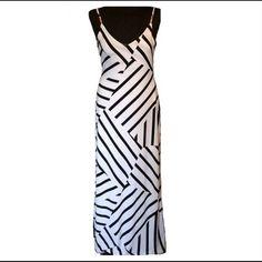 White black Maxi NWOT white black asymmetrical stretch maxi dress. Spaghetti straps. Poly spandex blend. Casual and comfortable! Please no trades, no PayPal! Dresses