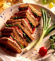 This layered sandwich recipe of pastrami, spinach, and vegetable cream-cheese spread, is sliced in quarters and threaded onto skewers. Serve it for lunch or dinner.