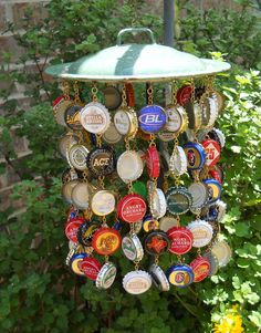 Hand made from 100 bottle caps and a re-purposed enamel pot lid this kitschy wind chime makes a colorful addition to porch or corner of the room.