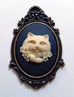 Ivory cat cameo brooch