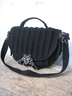 BAG  Beautifull black crocheted bag with 100% cotton in combination with leather by the side. On each side is a pocket that folds over and buckles with a