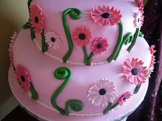 Beautiful  Pink Daisy Cake with black centers
