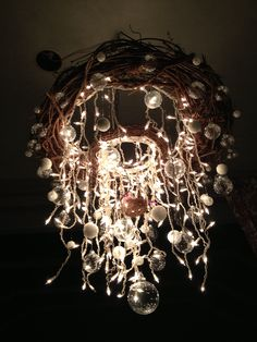 This was inspired by the hula hoop chandelier and bubble chandelier. I loved the idea of both but wanted to combine them. This is the results.