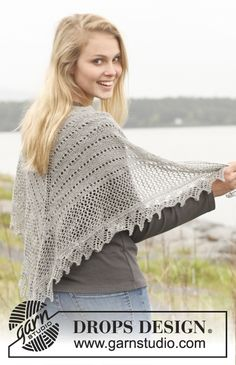 "Silver Mist - Knitted DROPS shawl in garter st with lace pattern in ""Lace"". - Free pattern by DROPS Design"