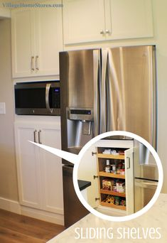 Slideing Shelves Beneath A Built In Microwave Allow For Extra Pantry Storage