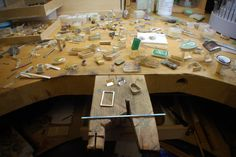 Chris Boland. Messy bench, I mean, errr, work in progress...    The bench pin is a work of art in and of itself!