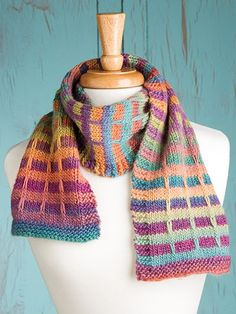 Free knitting pattern for Mock Plaid Scarf. Easy slipped stitch colorwork with two colors of multi color yarn. You could substitute a solid color if you want.