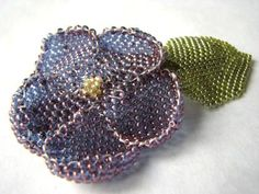 Purple flower barrette with green leaf handmade of woven seed beads by Wire Lotus