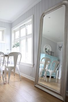 A large mirror to open up a small space and toss the light around.