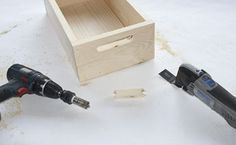 """Step 6:  Then, taking the top portion created in step 5, drill 3/4"""" holes 1' from the top edge and 3"""" from the both ends of the board. Using the Dremel Multi-Max, cut out the wood between the holes to form a handle slot. Repeat this on the opposite side so there are handles on both ends."""