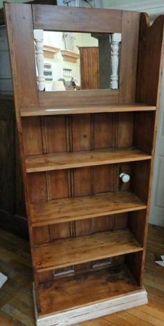 Beautiful and fun shelf made using a door for the back (you can see the door knob is still attached). Mirror on top adds even more character...