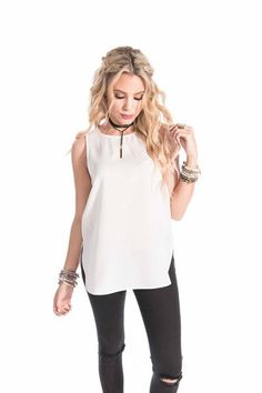 Every girl needs that perfect tank top to complete their look. This woven tank is complete with zipper detailing in the back for that perfect fit. Available i