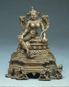 Tara,	12th century  India: West Bengal or Bangladesh, 1000-1099 Brass inlaid with silver 4-5/8 x 3-7/8 in. (11.7 x 9.8 cm)