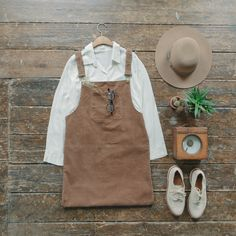 Read a book and relax its Friday. One pocket Corduroy dress and polka dot blouse online now. www.oliveclothing.com