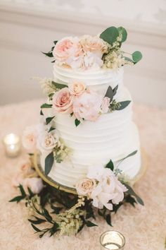 Gorgeous rose and astilbe topped wedding cake.