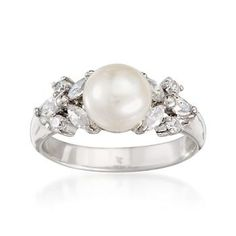 This beautiful 8mm cultured button pearl and .70 ct. t.w. CZ ring is the essence of elegance. Features a central pearl flanked by the shimmer of twinkling CZs. Sterling silver ring.  <i>CZ weights are diamond equivalents.</i> Free shipping & easy 30-day returns. Fabulous jewelry. Great prices. Since 1952.