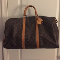 Louis Vuitton Authentic Keep All 50 Lovely LV Keepall 50. Leather has a honey patina no cracks or rips. Includes lock (not pictured) Louis Vuitton Bags Travel Bags