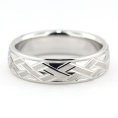 Carved men's wedding band. Band Name: Zach Band Width: 7 mm Band Finish: Satin