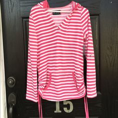NWT Long sleeve pink and white striped hooded top NWT! This is the softest hoodie I own. The inside is white and furry and feels amazing against your skin. Ties on the side and creates a ruching effect. Kangaroo pocket. Measures 25 inches from shoulder to hem. Thanks for looking. Marc New York Tops Sweatshirts & Hoodies