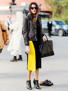 Style Tip: Pair a leather jacket and ankle booties with a vibrant, color-block skirt.