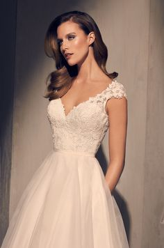 """@mikaellabridal   Style 2212, Mikaella Sequin Lace bodice with V-neckline and cap sleeves. Sweetheart neckline on lining. Fabric belt at waist. Full Organza skirt with 4"""" horsehair on hem and side seam pockets."""